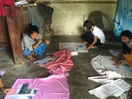Students practising sewing during the vocational training workshop