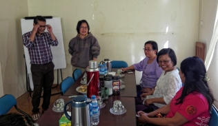 Friendly discussion and laughter at a meeting with the IRC